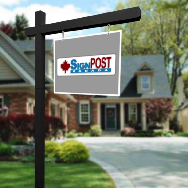 black real estate sign posts